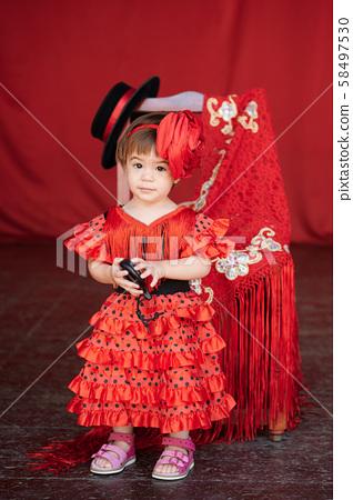 Baby kid in red flamenco dress 58497530
