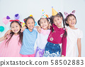 Group of adorable asian girls having fun at birthday party.. 58502883