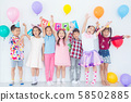 Group of adorable asian girls having fun at birthday party.. 58502885