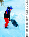 Cleaning snow in winter, the boy shovels snow. 58509023