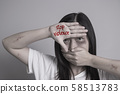 stop violence against women campaign. Asia woman with bruise on arms and face use one hand close mouth and the other hand write the word stop violence. 58513783