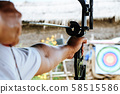 Archer holds his bow aiming at a target  58515586