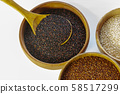 Red quinoa in a wooden bowl isolated on white background. 58517299