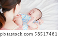 mother with her baby 58517461