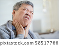 elderly man has sore throat 58517766