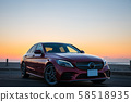 Wine red car and sunrise shore 58518935