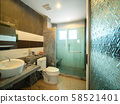 Interior of bathroom with toilet in warm light. 58521401