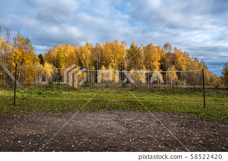 Volleyball net between metal poles against the 58522420