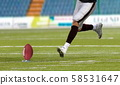 American football player kickoff on field 58531647
