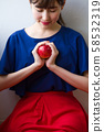 Young woman with an apple image 58532319