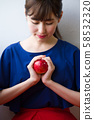 Young woman with an apple image 58532320