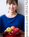 Young woman with an apple image 58532762