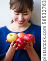Young woman with an apple image 58532763