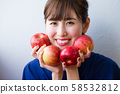 Young woman with an apple image 58532812
