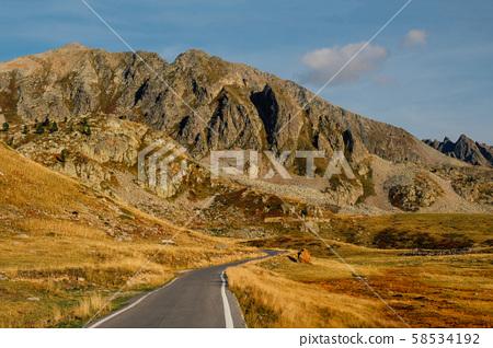 Mountain road in Col de la Lombarde high pass in the Alps 58534192
