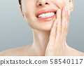 Tooth Pain And Dentistry. Young Woman Suffering From Strong Teeth Pain, Touching Cheek With Hand 58540117
