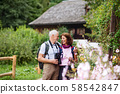 A senior pensioner couple with binoculars hiking, resting. Copy space. 58542847