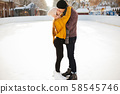 Cute couple in a ice arena 58545746