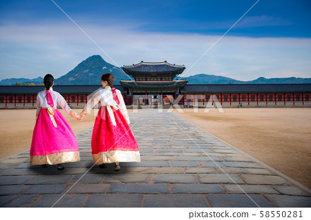 Asian girl in korean dress walking infront of gate 58550281