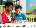 Student in international preschool reading a 58550510