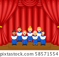 Choir children singing a song on the stage 58571554