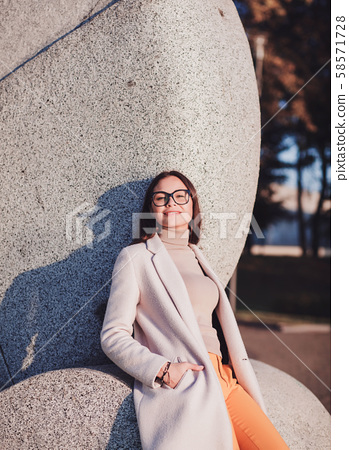 young girl in autumn coat 58571728