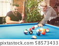 Employees playing in billiards at office 58573433