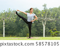 Young beautiful woman doing yoga exercise in green park. Healthy lifestyle and fitness concept. 58578105