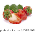 Ripe strawberries on white background 58581869