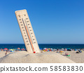 Thermometer for the temperature on the beach, in the summer in the heat. Global warming. 58583830