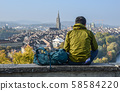A man looking at the old city from a height 58584220