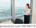 Pensive young business lady 58596570