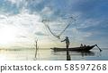 Reflection fisherman action when fishing net 58597268