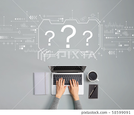 Question marks with person using laptop 58599091