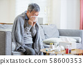 old asian man get a cold 58600353