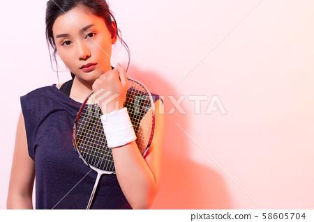 Female athlete badminton 58605704