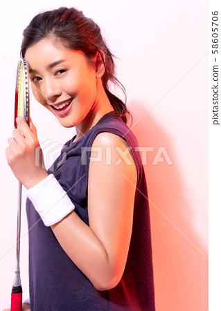 Female athlete badminton 58605706