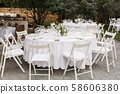 Wedding table setting decorated with fresh flowers 58606380