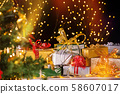 Christmas presents under Christmas tree 58607017
