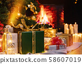 Christmas presents and candles under Christmas tree 58607019