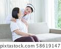 Nurse holding shoulder, see and smile to elderly 58619147