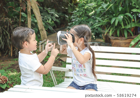 Kids Sister holding virtual reality, vr for boy 58619274