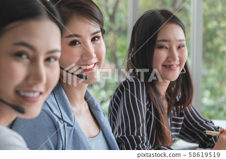 Beautiful female Smiling and friendly call-center 58619519