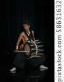Japanese Taiko drummer hits the drum on stage on a 58631632