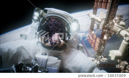 Astronaut at spacewalk. Elements of this image 58635809
