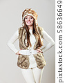 Winter cute girl fashion. 58636649