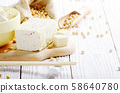 Soy Bean curd tofu in clay bowl and in hemp sack 58640780