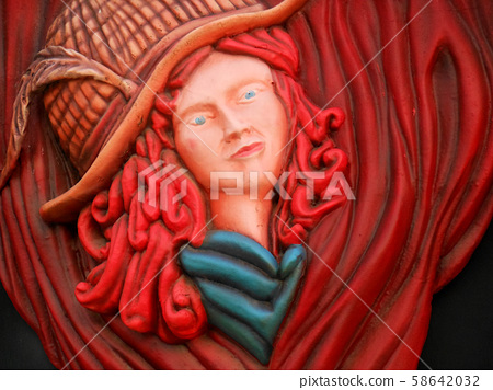Picture of a woman with red hair at the entrance of a bar 58642032