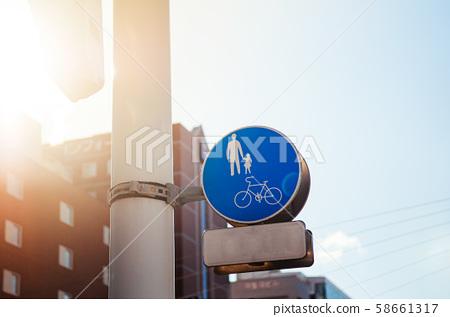 Blue Crosswalk pedestrian crossing sign against sunlight 58661317