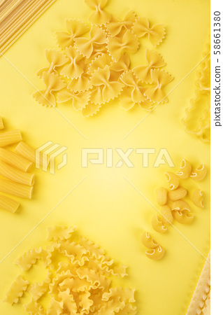 Italian pasta, flat lay banner with a place for text, an overhead shot on a yellow background, a 58661380